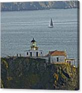 Lighthouse And Sailboat Canvas Print