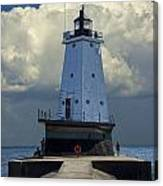 Lighthouse At The End Of The Pier In Ludington Michigan Canvas Print
