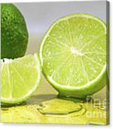 Limes On Yellow Surface Canvas Print