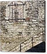 Limestone Wall With Door And Shadow Canvas Print