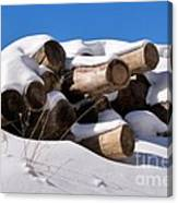 Log Pile In A Snow Drift In Winter Canvas Print