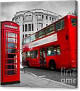 London Uk Red Phone Booth And Red Bus In Motion Canvas Print