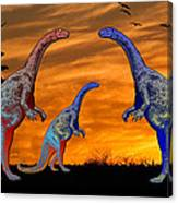 Long Necked Long Tailed Family Of Dinosaurs At Sunset Canvas Print