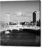 Looking Down The Liffey Towards The Hapenny Ha Penny Bridge Over The River Liffey In Dublin Canvas Print