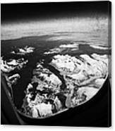 Looking Out Of Aircraft Window Over Snow Covered Fjords And Coastline Of Norway  Canvas Print