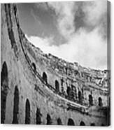 Looking Up At Blue Cloudy Sky And Upper Tiers Of The Old Roman Colloseum At El Jem Tunisia Canvas Print