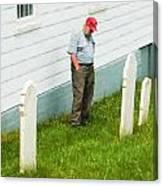 Man At Headstone Canvas Print