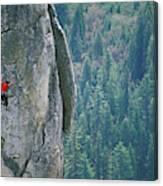 Man Climbing On A Big Granite Spire Canvas Print