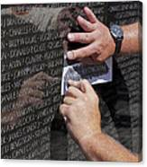Man Getting A Rubbing Of Fallen Soldier's Name At The Vietnam War Memorial Canvas Print
