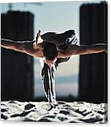 Man Holding Yoga Pose In The Sand Canvas Print