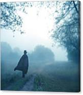 Man In Top Hat And Cape On Foggy Dirt Road Canvas Print