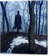 Man In Top Hat Walking Through Foggy Woods Canvas Print