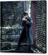 Man In Trenchcoat Lighting A Cigarette Canvas Print
