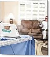 Man Ironing Shirt Canvas Print