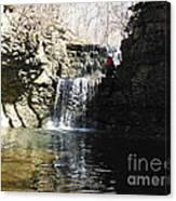 Man On A Waterfall Ledge Canvas Print