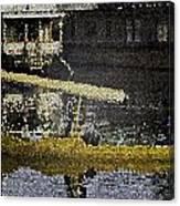Man Plying Wooden Shikara In Dal Lake Canvas Print
