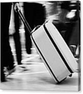 man pulling red wheeled luggage out of Reina Sofia Sur TFS South Airport Tenerife Canary Islands Spain Canvas Print