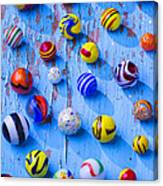 Marbles On Blue Board Canvas Print