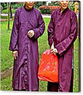 Maroon-robed Monks At Buddhist University In Chiang Mai-thailand Canvas Print