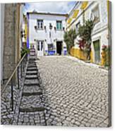 Medieval Cobblestone Street In The Fortified Walled European Village Of Obidos Canvas Print