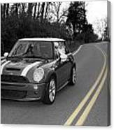 Mini-cooper Car Driving On Double Yellow Country Road Canvas Print