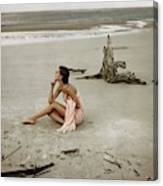 Model Wrapped In A Pink Towel On The Beach Canvas Print