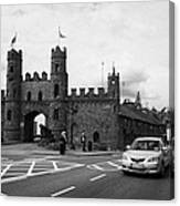 modern traffic driving past Entrance to Macroom Castle County Cork Ireland Canvas Print