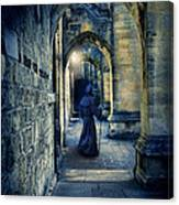 Monk In A Dark Corridor Canvas Print