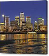 Moonrise Over River Thames Flowing Past Canary Wharf Canvas Print