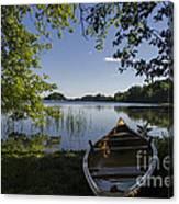 Morning Light On A Canoe Canvas Print