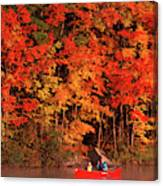 Mother And Son Canoeing Near Fall Canvas Print