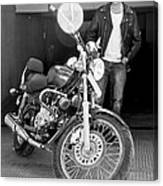 Motorbiker Looks On Dotingly Canvas Print