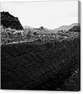 mound of Turf peat cut next to the cut seam in a peat bog in Connemara Canvas Print