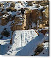 Mountain Biker Jumping With Snowy Canvas Print