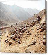 Mountain Biker Rides Through Rocky Canvas Print