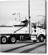 municipal city dump truck taking away snow cleared from parking lots and roads in Saskatoon Saskatch Canvas Print
