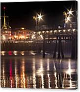 Night On Santa Monica Beach Pier With Bright Colorful Lights Reflecting On The Ocean And Sand Fine A Canvas Print