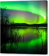 Northern Lights Mirrored On Lake Canvas Print