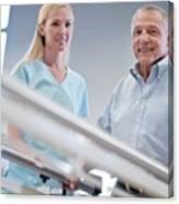 Nurse With Senior Man Using Parallel Walking Bars Canvas Print