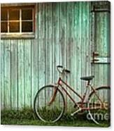 Old Bicycle Leaning Against Grungy Barn Canvas Print