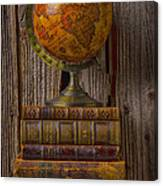 Old Globe On Old Books Canvas Print