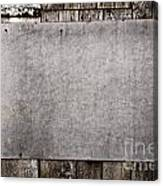 Old Grunge Plywood Board On A Wooden Wall Canvas Print