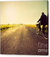 Old Man Riding A Bike To Sunny Sunset Sky Canvas Print