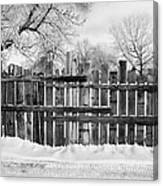 old patched up wooden fence using old bits of wood in snow Forget Saskatchewan  Canvas Print