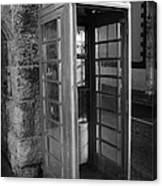 old style red telephone box with missing door in Carnlough county antrim Canvas Print