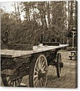 Old Wagon With Antique Water Wheel Canvas Print