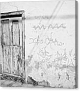 old weathered green painted wooden door entrance to abandoned house with cracked stucco walls and graffitti in Tacoronte Tenerife Canary Islands Spain Canvas Print