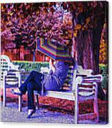 On A Bench Under An Umbrella In Autumn Canvas Print