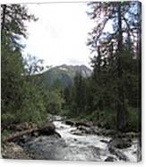 On The Shore Of A Mountain River With Mountain View Canvas Print
