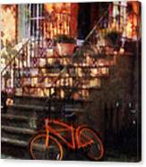 Orange Bicycle By Brownstone Canvas Print
